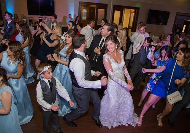 Bride and Groom Dancing with Guests on Dance Floor