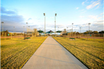 Concrete Path Leading to Bob Jones Park With Park Showing in the Distance