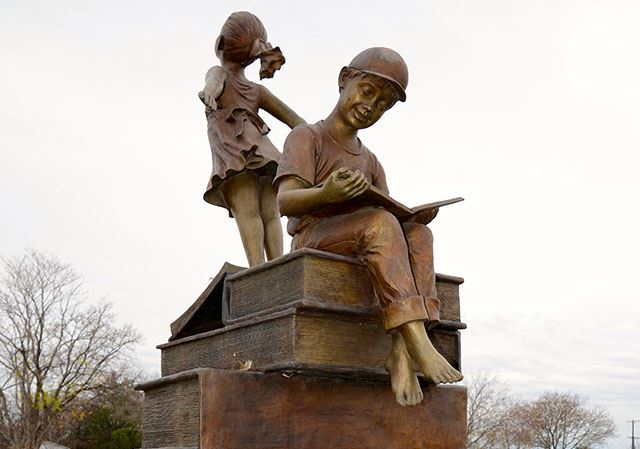 Girl and Boy on Books Bronze Sculpture